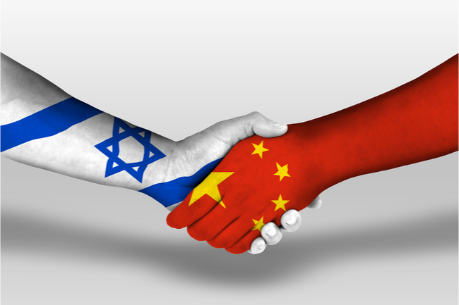 israeli and chinese flags - shaking hands